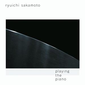 Playing the piano, Sakamoto
